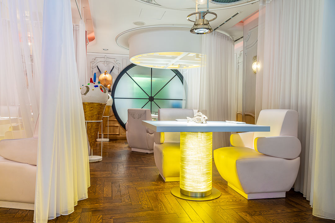 DiverXO by Hungry for More. Interior of the restaurant with white chairs.