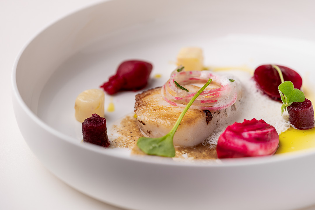 The White Room by Hungry for More. Detail of meat dish with cod, beetroot, celeriac and garam masala.