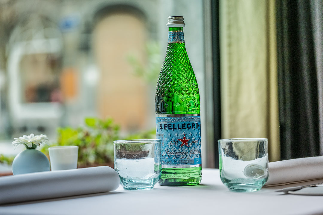 La Canne en Ville by Hungry for More. Bottle of S.Pellegrino water on the table of the restaurant.