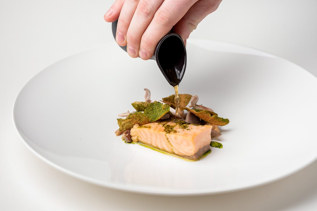 La Canne en Ville by Hungry for More. Chef Kevin Lejeune pouring the sauce on the salmon dish.