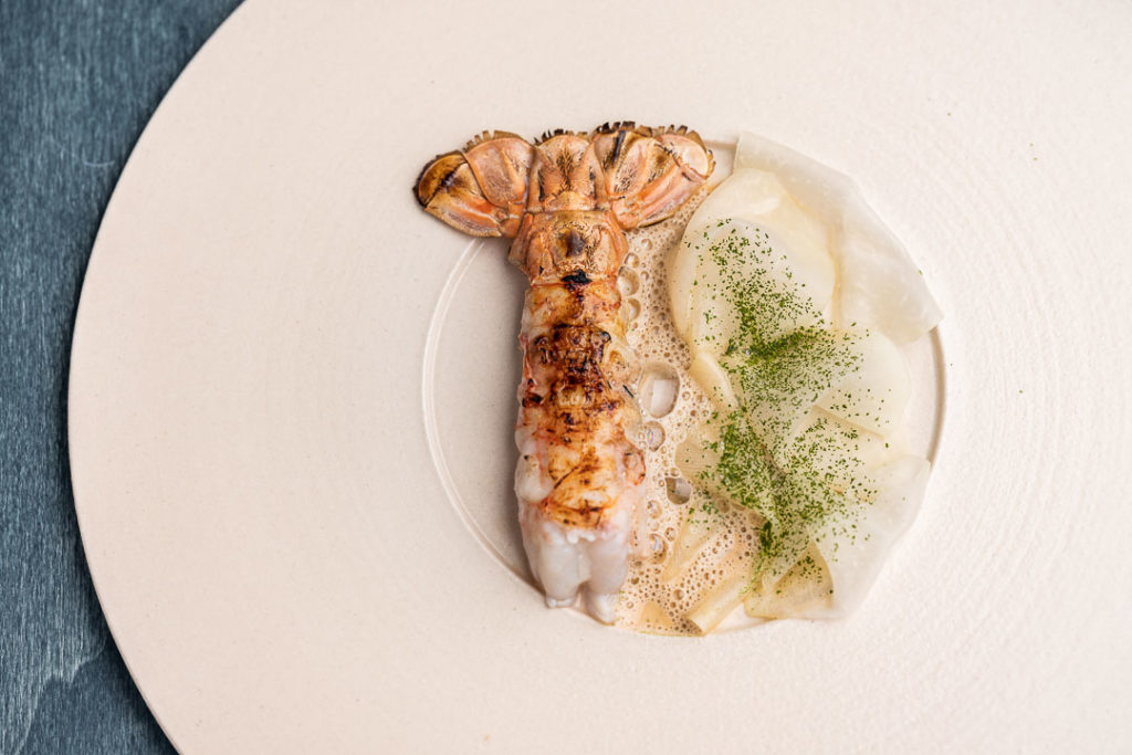 Langoustine on the Konro grill, marinated kohlrabi and powder of lovage
