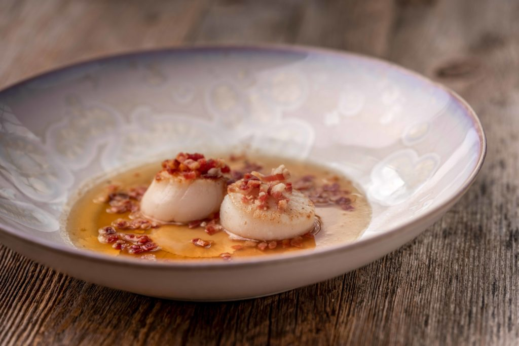Scallops with maple syrup and pancetta of Biestro H-eat