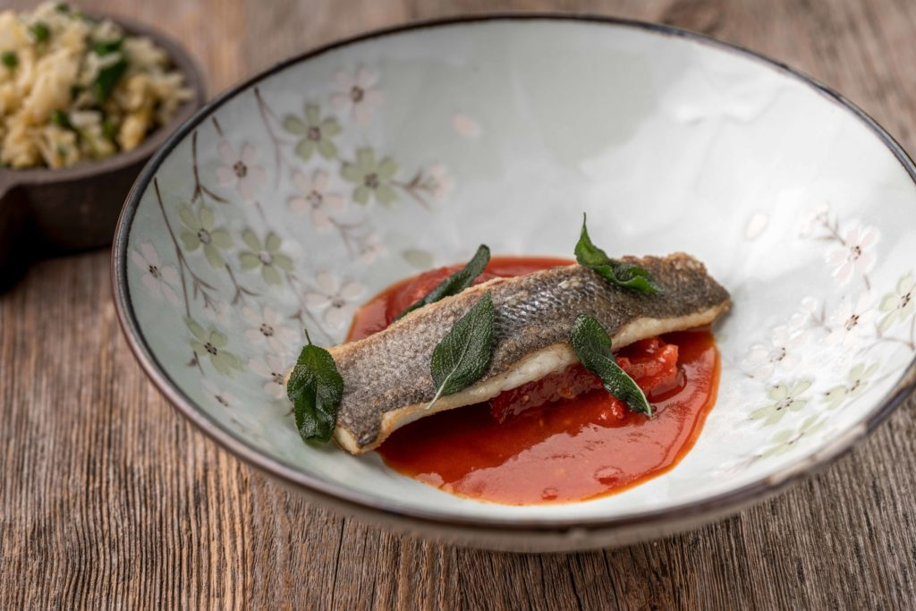 Singapore sea bass with tomato, soya, palm sugar, fried rice, egg threads and peas of Biestro H-eat